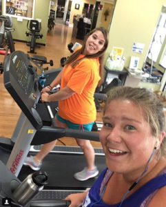 Alex McWhorter hops on the treadmill during her lunch break with a fellow co-worker