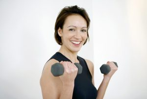 Stock Photo 1706600 Woman lifting weights