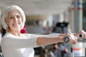 Stock Photo - 64938299_ml - Senior Woman with Weights